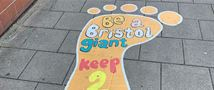 Giant foot graphics encourage social distancing